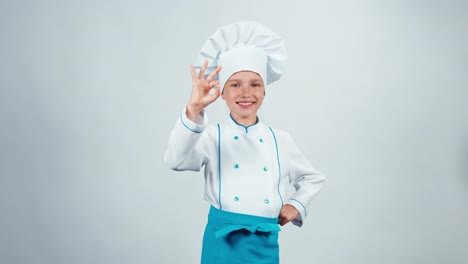 Chef-Cook-Child-7-8-Years-Showing-Okey-At-Camera-Standing-Isolated-On-White