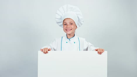 Chef-Cook-Child-7-8-Years-Standing-Behind-Whiteboard-And-Smiling-At-Camera
