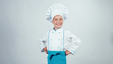 Chef-Cook-Child-7-8-Years-Turned-At-Camera-And-Smiling-Standing-Isolated
