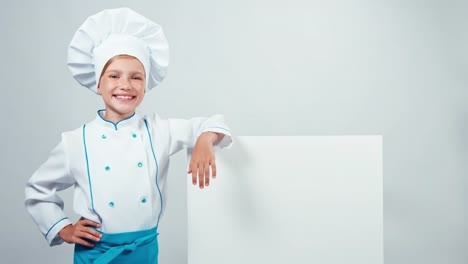 Chef-Cook-Child-Near-The-Whiteboard-And-Smiling-At-Camera-With-Teeth-Isolated