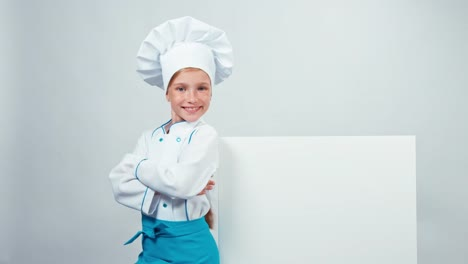 Chef-Cook-Child-Pointing-To-Whiteboard-And-Smiling-At-Camera-With-Teeth