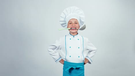 Chef-Cook-Holding-Soup-Ladle-In-Teeth-And-Smiling-At-Camera-Thumb-Up-Ok