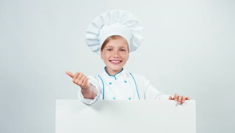 Chef-Girl-In-Uniform-7-8-Years-Behind-The-Whiteboard-And-Has-Hand-Near-Face