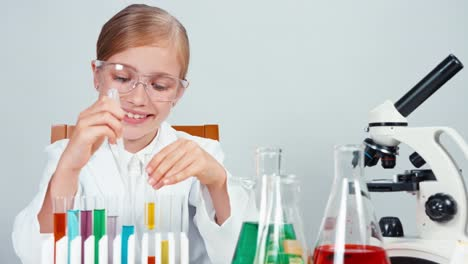 Chemist-Mixing-Chemicals-In-Test-Tube-And-Smiling-At-Camera-With-Teeth