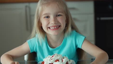 Portrait-Of-A-Girl-Eating-Strawberries-With-Cream