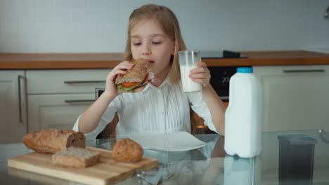 Portrait-Of-A-Girl-Preschooler-In-The-Kitchen-Girl-Holding-A-Sandwich-01