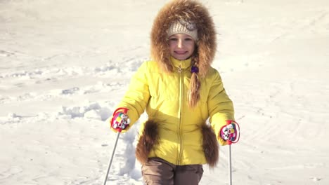 Portrait-Of-Child-Girl-Is-Making-First-Steps-On-Skis