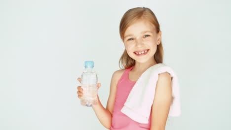 Portrait-Sportswoman-Girl-Child-Showing-Bottle-Of-Water-Thumb-Up-Ok