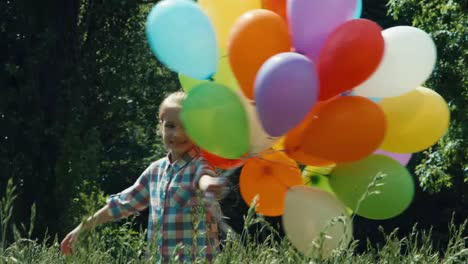 Preschooler-Girl-With-Balloons-Whirling-In-The-Park