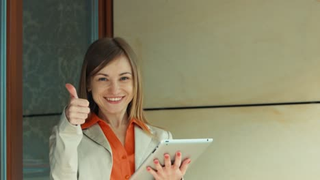Pretty-Business-Woman-Showing-Her-Success-On-The-Tablet-PC