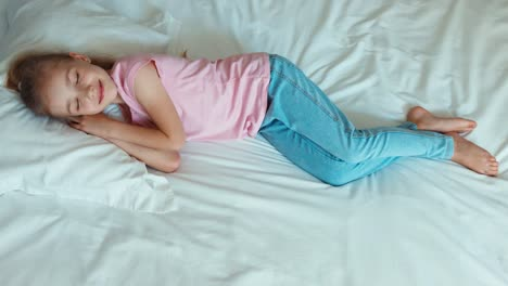Pretty-Girl-6-8-Years-Old-Sleeping-In-The-Bed-Top-View