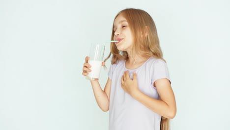 Satisfied-Child-Drinking-Milk-Stroking-Tummy-Girl-With-Beautiful-Blonde-Hair