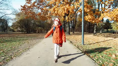 Schoolgirl-Running-At-The-Camera-In-The-Park-In-The-Autumn