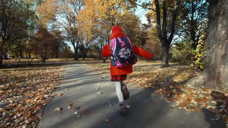 Schoolgirl-Running-In-The-Park-In-The-Autumn