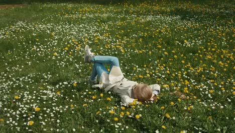 Spring-Weather-Child-Lying-On-The-Grass