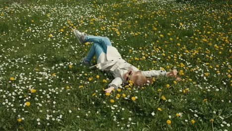 Spring-Weather-Child-Lying-On-The-Grass-And-Relaxing-Sunlight