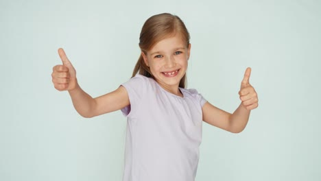 Thumbs-Up-Ok-Girl-Is-On-The-White-Background-And-Smiling-At-Camera