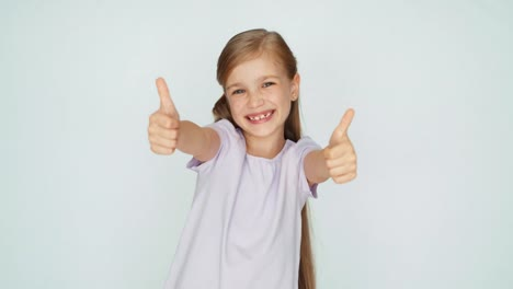 Thumbs-Up-Ok-Girl-Laughing-At-Camera-Child-Is-On-The-White-Background-01
