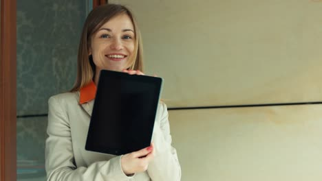 Very-Pretty-Business-Woman-Showing-Her-Success-On-The-Tablet-PC