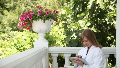 Young-Adult-In-A-Bathrobe-With-A-Tablet-PC-Woman-Is-Online