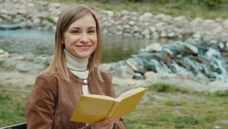Young-Adult-Woman-Reading-A-Book-Girl-Sitting-On-A-Bench-In-The-Park
