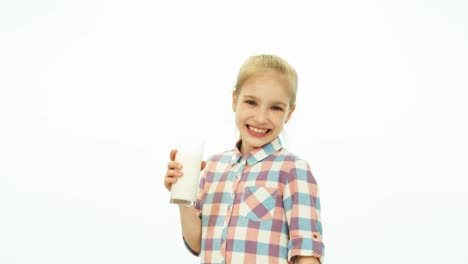 Child-Girl-Holding-Glass-And-Drinking-Milk-And-Smiling-At-Camera