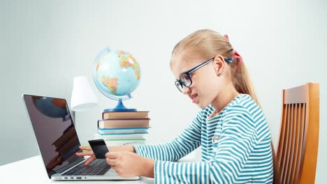 Child-Schoolgirl-7-8-Years-Using-Credit-Card-And-Laptop-Isolated-On-White
