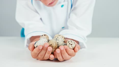 Close-Up-Hands-Of-Chef-Cook-Holds-Quail-Eggs
