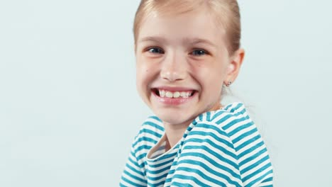 Close-Up-Portrait-7-8-Years-Girl-Smiling-At-Camera-With-Teeth-Isolated-On-White