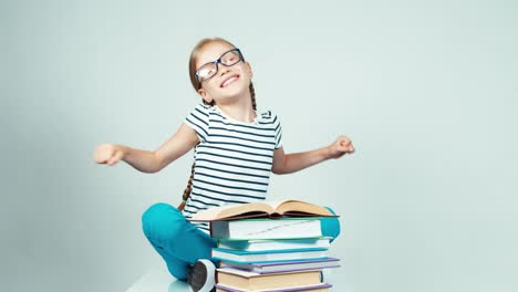 Close-Up-Portrait-7-8-Years-Old-Girl-Reading-Book-And-Stretching