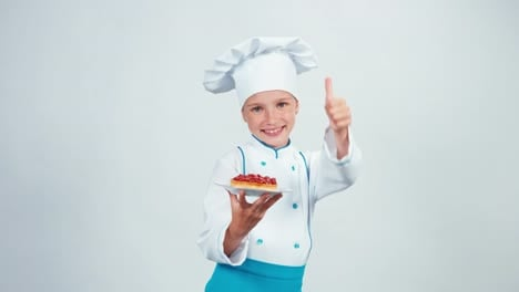 Close-Up-Portrait-Baker-Holds-Little-Cake-With-Raspberries-And-Standing-Isolated