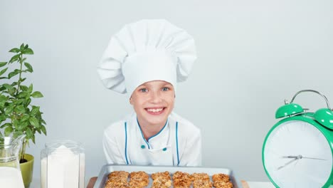 Close-Up-Portrait-Chef-Cook-Girl-Child-7-8-Years-Has-Baking-Tray-With-Biscuits