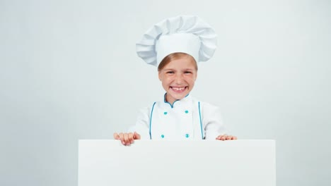 Close-Up-Portrait-Chef-Hides-Behind-The-Whiteboard-And-Laughing-At-Camera