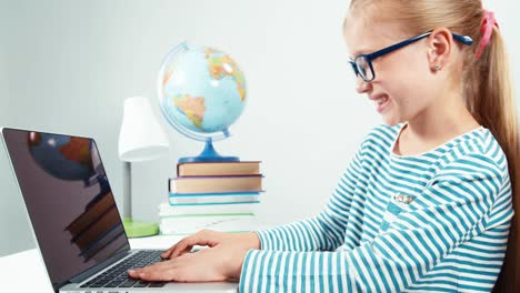 Close-Up-Portrait-Child-7-8-Years-Old-Something-Typing-On-Her-Laptop