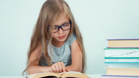 Close-Up-Portrait-Cute-Student-Girl-7-8-Years-In-Glasses-Reading-Book
