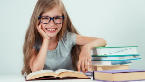 Student-Girl-With-Long-Blond-Hair-7-8-Years-In-Glasses-Reading-Book-And-Smiling