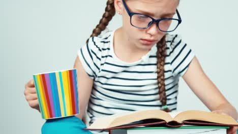 Close-Up-Portrait-Girl-7-8-Years-Old-Reading-Book