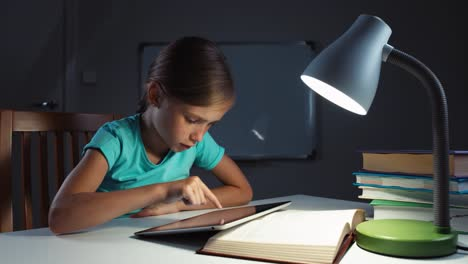 Close-Up-Portrait-Girl-Child-7-8-Years-Old-Using-Tablet-PC-In-The-Night