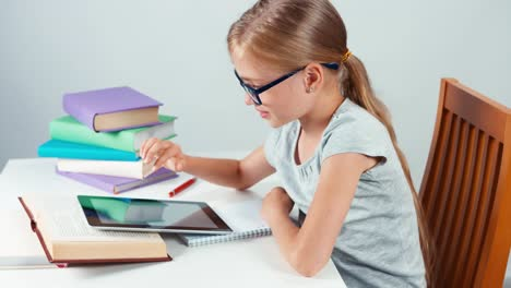 Close-Up-Portrait-Girl-Child-Student-Using-Tablet-PC-In-The-Table-And-Smiling