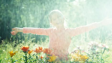 Girl-standing-under-sprinkler-in-the-garden-on-a-sunny-day-1