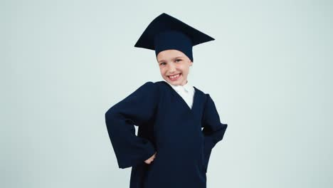 Close-Up-Portrait-Graduate-Girl-7-8-Years-In-The-Mantle-And-Hat-Thinking
