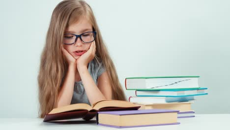 Close-Up-Portrait-Happy-Girl-With-Long-Blond-Hair-7-8-Years-In-Glasses-Reading