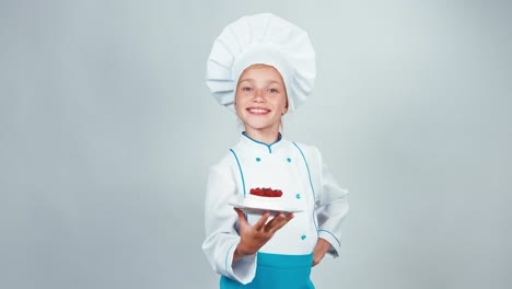 Close-Up-Portrait-Little-Chef-Cook-Holds-Biscuit-Cake-Gives-You-And-Smiling