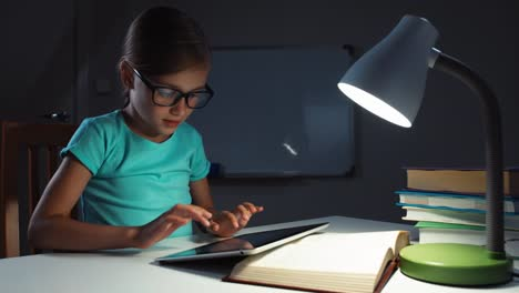 Close-Up-Portrait-School-Girl-7-8-Years-Old-In-Glasses-Using-Tablet-In-The-Night