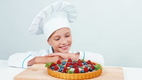 Close-Up-Portrait-Young-Baker-Near-Chocolate-Cake-With-Sweets-And-Fruits