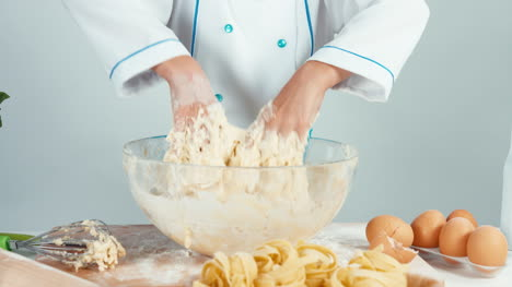 Close-Up-View-Of-Hands-Young-Baker-Girl-Making-Dough