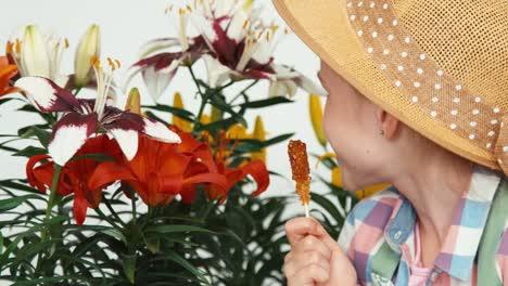 Closeup-Portrait-Flowergirl-Child-In-Hat-Sitting-Near-Flowers
