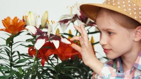 Closeup-Portrait-Flowergirl-Child-Sitting-Near-Flowers-And-Eating-Lollipop