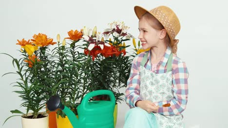 Closeup-Portrait-Flowergirl-Child-Sitting-Near-Flowers-And-Watering-Can