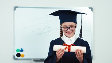 Closeup-Portrait-Little-Student-Girl-7-8-Years-Graduate-In-The-Mantle-Kissing